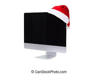 Computer screen in santa hat