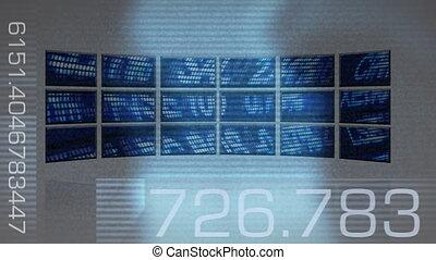 Computer screens projecting stock market data.
