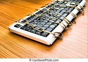 Computer security concept with keyboard and chain