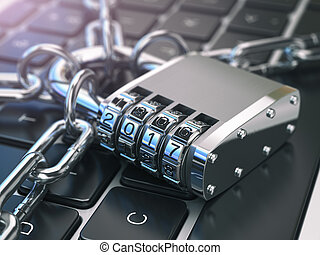 .Computer security or safety concept. Laptop keyboard with lock password 2017 and chain.