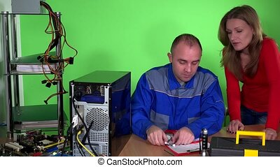 Computer specialist guy with stethoscope examining pc and customer girl