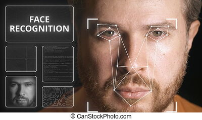 Computer system scanning man's face. Face recognition...