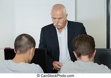 computer teacher and his students