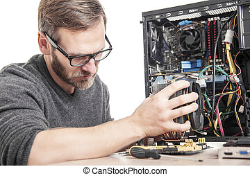 Computer technician installs cooling system.