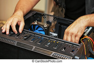 Computer technician installs system of computer. Assembling PC