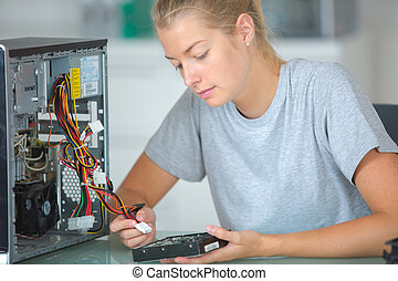 Computer technician working on computer
