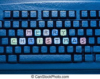 computer toetsenbord, met, veelkleurig, tekst, zalige kerst, op, knopen, bedekt, met, sneeuw, verlicht, door, blauwe , neon ontsteken