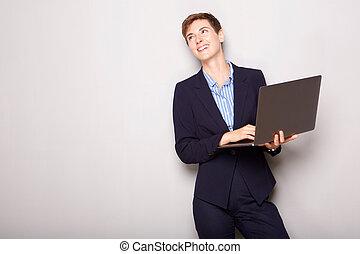 computer, vasthouden, businesswoman, vrolijke , jonge, draagbare computer