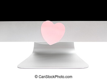 Computer with a sticky note in the shape of a heart