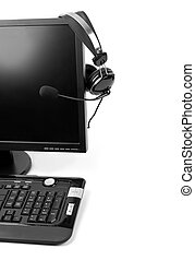 Computer with VOIP headset hanging on the screen, isolated...