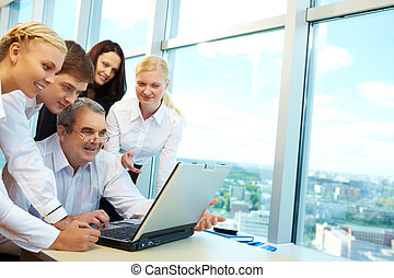 Computer work - Photo of happy co-workers planning work...