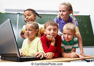 Computer work - Portrait of smart schoolgirls and schoolboy...