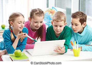 Computer work - Portrait of smart schoolgirls and schoolboys...