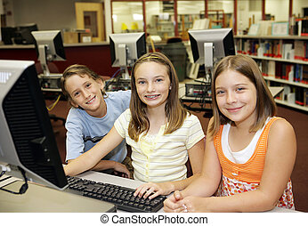 Computers in the Classroom - A group of students learning...