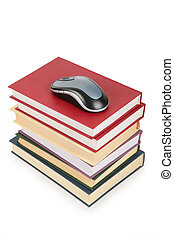 computer`s mouse on pile of books