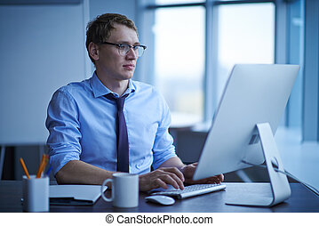 Computing - Young successful businessman networking in...