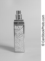 Concealer in bottle on a gray background