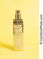 Concealer in bottle on a yellow background