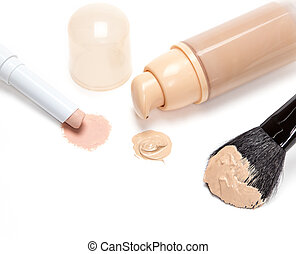 Concealer pencil and foundation with makeup brush - Close-up...
