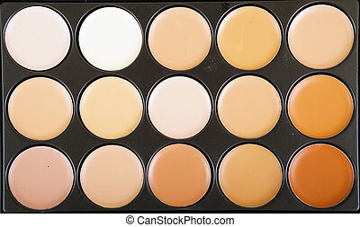 Concealers closeup.Set of decorative nude cosmetics for makeup.
