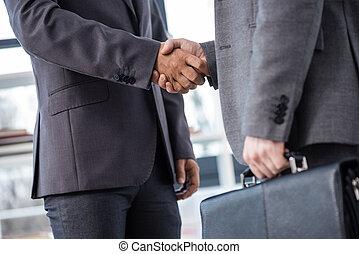 conceito, negócio, agitação, escritório, recortado, homens negócios, mãos, reunião, vista