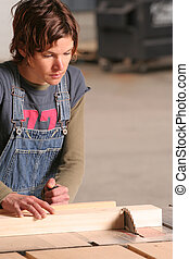 A cross cut being made on a table saw.