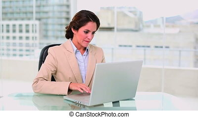 Concentrated attractive businesswoman