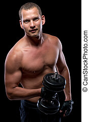 concentrated bodybuilder in training with dumbbells