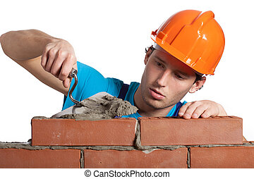 Concentrated bricklayer putting - A bricklayer putting ...