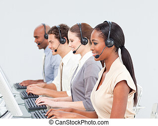 Concentrated business team working in a call center