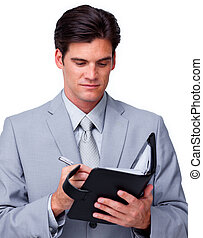 Concentrated businessman consulting his agenda