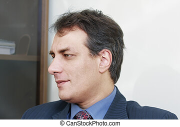 Concentrated businessman sideview