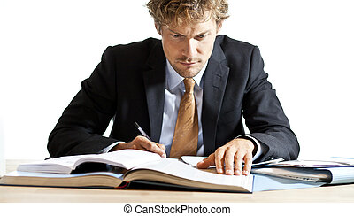Concentrated businessman working at desk