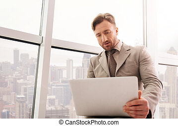 Concentrated businessman working in the office