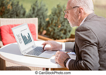 Concentrated businessman working on the laptop