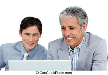 Concentrated businessmen working at a computer