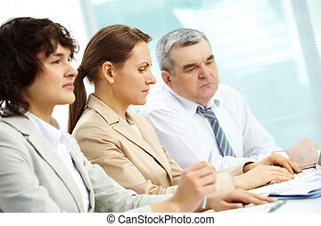 Concentrated businesspeople - Attentive businesspeople being...
