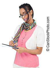 Concentrated cool woman writing in notepad