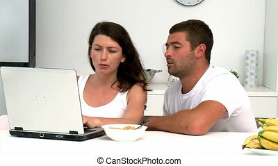 Concentrated couple buying on internet with a credit card