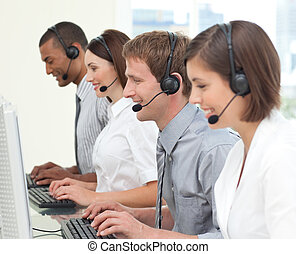Concentrated customer service agents working in a call...