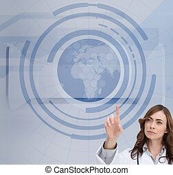 Concentrated doctor pointing at holographic globe -...