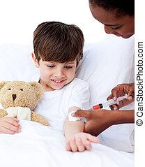 Concentrated female doctor giving a child an injection