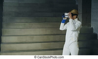 Concentrated fencer woman practice fencing exercises using...
