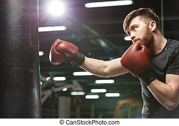 Concentrated handsome young strong sports man boxer