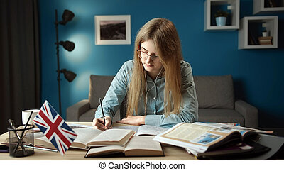 Concentrated lady learning English