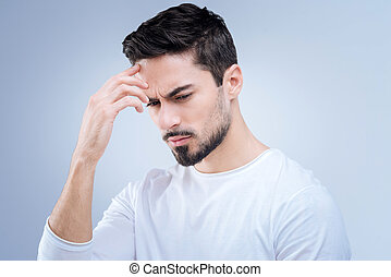 Concentrated man trying to remember the phone number of his friend