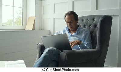 Concentrated man working with a laptop