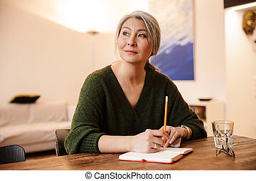 Concentrated mature beautiful grey-haired woman - Image of ...