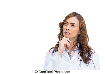 Concentrated pretty doctor posing on white background