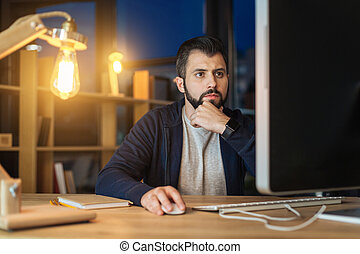Concentrated programmer being in office at night